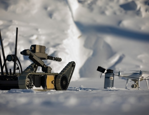 An explosive ordnance disposal team with 7th Engineer Support Battalion, 1st Marine Logistic Group, utilize a water charge placed by a small unmanned ground vehicle to neutralize a civilian drone in Fort Greely, Alaska, Feb. 25, 2020, as a part of U.S. Northern Command exercise Arctic Edge 2020. Marines participating in the training will gain the knowledge and skills necessary to maintain readiness in arctic regions including Alaska, the most strategic place in the world. (Christopher England/Marine Corps)