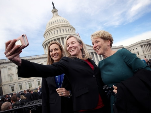 Newly elected Reps. Mikie Sherrill, D-N.J., left, Abigail Spanberger, D-Va., center, and Chrissy Houlahan, D-Pa., right, pose for a picture in front of the U.S. Capitol on Nov. 14, 2018. Sherrill, a former U.S. Navy helicopter pilot, and Houlahan, a former Air Force officer, were named to the House Armed Services Committee this week. (Win McNamee/Getty Images)