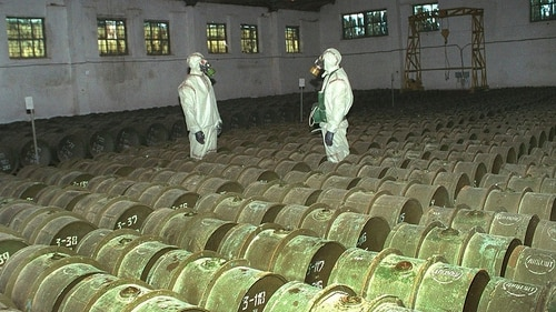 In this Saturday, May 20, 2000 file photo, two Russian soldiers make a routine check of metal containers with toxic agents at a chemical weapons storage site in the town of Gorny, 124 miles (200 kms) south of the Volga River city of Saratov, Russia. Last year, Russia announced it fully completed the destruction of its Soviet-built chemical arsenals, an effort that spanned decades. The gulf between Russia and Britain widened on Friday, March 16, 2018, as they cranked up pressure over a nerve agent attack and a suspected murder in Britain that have deepened Western worries about alleged Russian meddling abroad. (AP Photo)