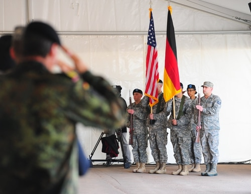 Attendees salute the U.S. and German flags during the groundbreaking ceremony here for the Rhine Ordnance Barracks Medical Center Replacement, Oct. 24, 2014, in Weilerbach, Germany. (Sgt. Daniel Cole/Army)