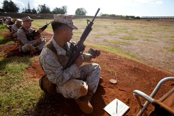 U.S. Marine 2nd Lieutenant Marcelino M. Figueroa, 1st platoon commander with 1st Battalion 3d Marines, reloads during a live-fire operation at Pu'uloa Rifle Range near Ewa Beach, Hawaii, September 24th, 2013. U.S. Marines with Marine Corps Base (MCB) Hawaii attended the range for their annual rifle qualification. (U.S. Marine Corps photo by Lance Cpl. Aaron S. Patterson, MCBH Combat Camera/Released)