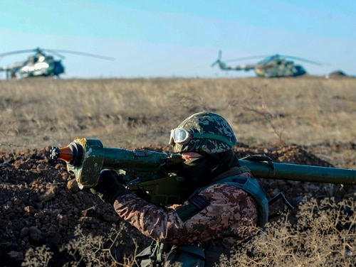 A Ukrainain soldier attends a military drill near Urzuf village not far from the city of Mariupol, eastern Ukraine, on Nov. 29, 2018. (Sega Volskii/AFP via Getty Images)