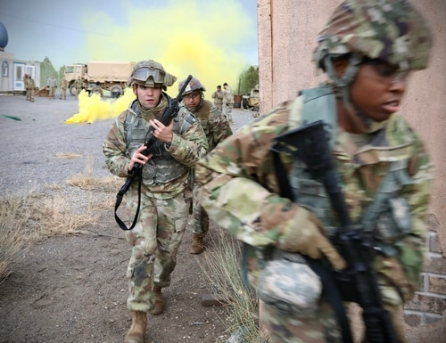 A group of Army Reserve Soldiers from the 76th Operational Response Command move between buildings after conducting building clearing operations during an urban assault mission on Camp Williams, Utah, April 16. (Photo by Sgt. 1st Class Brent C. Powell/U.S Army)