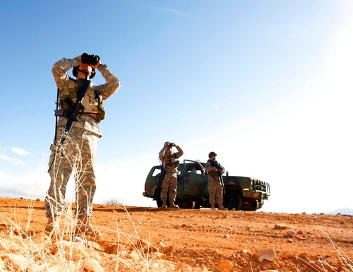 In this Jan. 19, 2007, file photo, a National Guard unit patrols at the Arizona-Mexico border in Sasabe, Ariz. (Ross D. Franklin/AP)