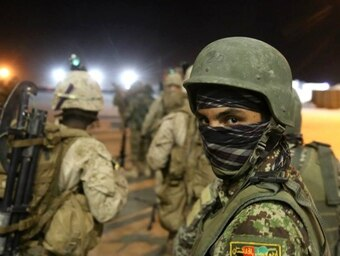 An Afghan National Army soldier follows Marines with Bravo Company, 1st Battalion, 7th Marine Regiment, onto a CH-53E Super Stallion helicopter during the start of a mission in Helmand province, Afghanistan, Aug. 16, 2014. (Sgt. Joseph Scanlan/Marine Corps)