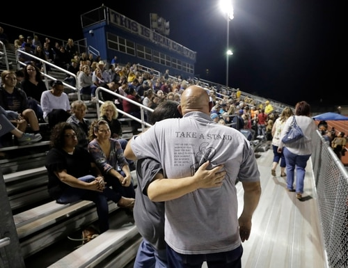 Attendees make their way through the stands of a football stadium before a vigil for the First Baptist Church shooting victims Tuesday, Nov. 7, 2017, in La Vernia, Texas. (David J. Phillip/AP)