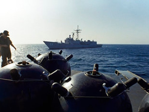 This Sept. 21, 1987, file photo shows mines aboard the Iranian ship Iran Ajr being inspected by a boarding party from the USS Lasalle in the Persian Gulf. (Mark Duncan/AP)