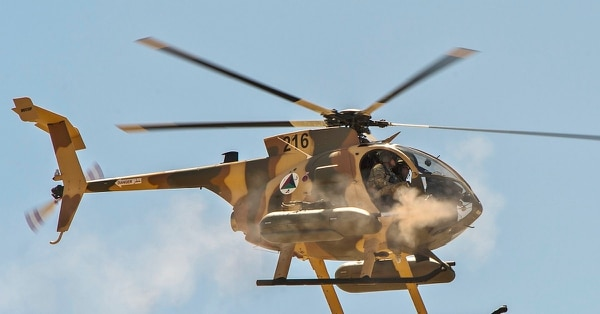 An Afghan MD 530 helo targets during a training scenario with tactical air coordinators. (U.S. Defense Department)