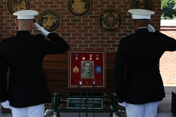 Marine Raiders currently assigned to Company B, 1st Marine Raider Battalion and U.S. Marine Corps Forces, Special Operations Headquarters render honors and a final salute to Sgt. John C. Holladay during his memorial service in Florence, S.C., April 4, 2016. Holladay, a World War II Marine Raider was killed in action while assigned to Company B, 1st MRB in 1943. Holladay returned to his home in Florence, after 73 years.