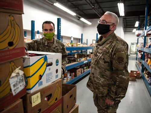 Command Chief Master Sgt. James Duty and Pfc. Brayden Moon explains foodbank operations at the Toledo Northwestern Ohio Food Banks, May 27, 2020. (Senior Master Sgt. Beth Holliker/Air National Guard)