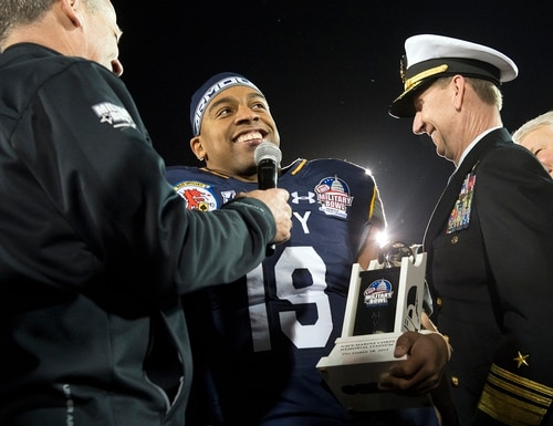 Navy's Keenan Reynolds accepts the Most Valuable Player trophy for Navy's 44-28 victory over Pittsburgh in the 2015 Military Bowl at Navy-Marine Corps Stadium in Annapolis, Md., Dec. 28, 2015. (EJ Hersom/DoD)
