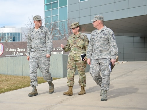 Air Force Gen. John E. Hyten, head of U.S. Strategic Command (left) and Army Col. Kathryn Spletstoser (center) leave the Army Space and Missile Defense Command at Peterson Air Force Base in Colorado on Nov. 14, 2017. Spletstoser has publicly accused Hyten of sexually assaulting her in a hotel room just a few weeks after this photo was taken. (Sgt. Zach Sheely/Army)
