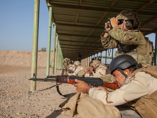 An Iraqi soldier zeros his rifle during marksmanship training with Coalition forces. (Photo by Sgt. Joshua Wooten)