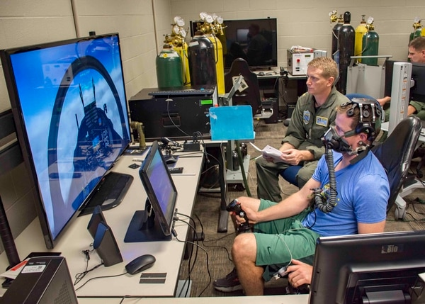 Navy Lt. Clayton Shaw, an instructor pilot with Training Squadron 10, helps test equipment meant to provide early warning signs to pilots before they feel the effects of hypoxia. (Mass Communication Specialist 2nd Class Michael J. Lieberknecht/Navy)