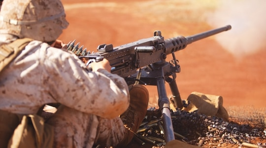 Pfc. Daniel Stillwell, a machine gunner with Charlie Company, 1st Battalion, 3rd Marine Regiment, shoots the .50 caliber M2 Browning machine gun during crew-served weapons training at Schofield Barracks, Oct. 8 through 10, 2013. (Lance Cpl. Suzanna Knotts/Marine Corps)