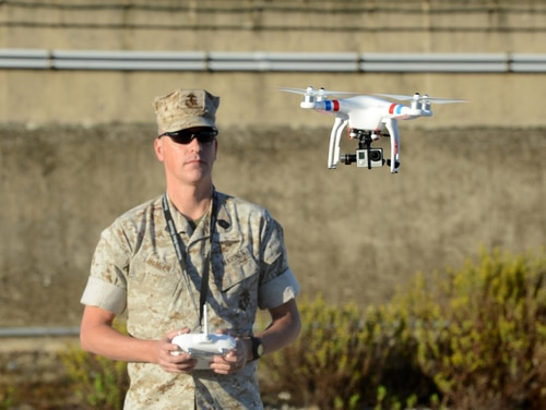 The U.S. Marine Forces Europe and Africa deputy director of communication, Master Sgt. Chad E. McMeen, uses a commercial-grade quadcopter to capture video footage of the USNS William R. Button on the pier in Rota, Spain. (Visual Information Specialist Jason Johnston/U.S. Army)