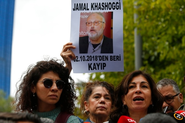 Activists, members of the Human Rights Association Istanbul branch, holding posters with photos of missing Saudi journalist Jamal Khashoggi. They talked to the media during a protest in his support near the Saudi Arabia consulate in Istanbul on Tuesday. The poster reads in Turkish: ' Jamal Khashoggi, missing since October 2, 2018'. Khashoggi disappeared after entering Saudi Arabia's consulate to obtain paperwork required for his marriage to his Turkish fiancee. Turkish officials have alleged he was killed in the compound while Saudis officials said he left the building unharmed. (Lefteris Pitarakis/AP)