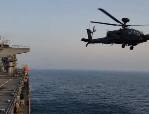 An AH-64D Apache from UAE Joint Aviation Command launches from the flight deck of the Lewis B. Puller (Chief Petty Officer Thomas Joyce/Navy)