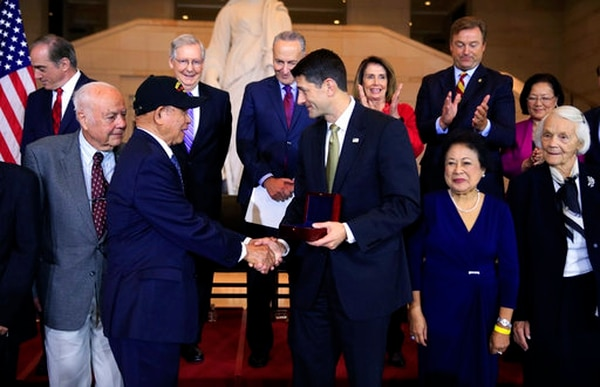 Speaker of the House Paul Ryan of Wisconsin congratulates Aquilino Delen and other Filipino veterans and their next of kin, Frank Francone, front left, Alicia Benitez, second from right, and Margrit Baltazar, right, during a ceremony awarding the Congressional Gold Medal to Filipino veterans of World War II at the Emancipation Hall on Capitol Hill in Washington, Wednesday, Oct. 25, 2017. Standing with the recipients are, from left back row, Veterans Affairs Secretary David Shulkin, Senate Majority Leader Mitch McConnell of Ky., Senate Minority Leader Chuck Schumer of New York, House Minority Leader Nancy Pelosi of Calif., Sen. Dean Heller, R-Nev., Sen. Mazie Hirono, D-Hawaii, and Rep. Ed Royce, R-Calif.(Manuel Balce Ceneta/AP)