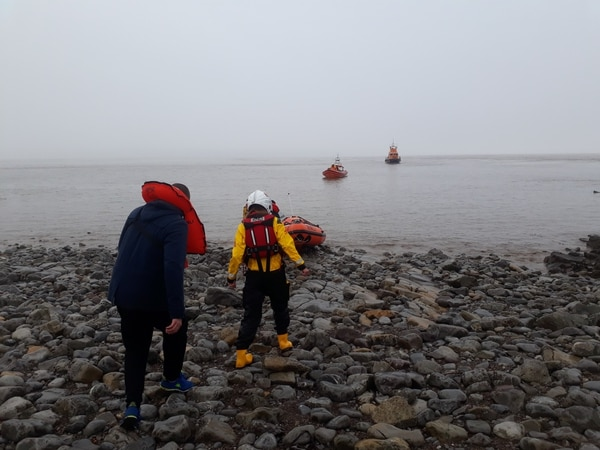 A sailor from a Russian cargo ship is helped off a deserted island after a drunken boat ride gone wrong. (RNLI)