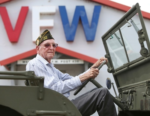 Don Foran, who as a teenager spent the last months of World War II on dangerous assignments driving a jeep, restored and donated the same model of a 1942 jeep to the Canyon VFW post. (Lauren Koski/The Amarillo Globe News via AP)