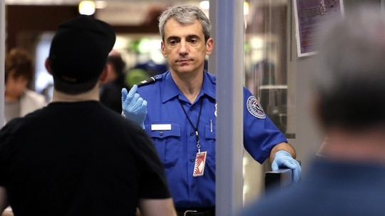 Transportation Security Agency staff are among the many federal employees in the air and space transportation industry that must work without pay during the partial government shutdown. (Elaine Thompson/AP)