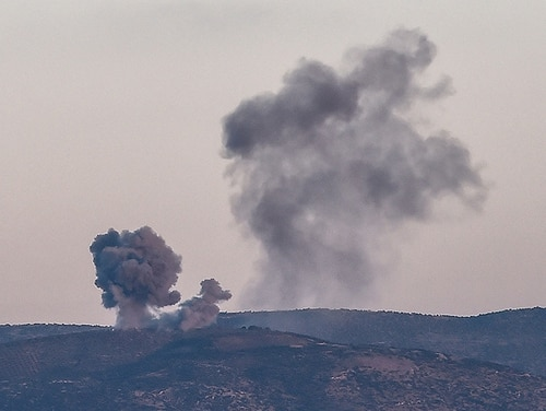 This photo taken on Jan. 28, 2018 shows smoke rising on the Syrian side of the border from Hassa, near Hatay, southern Turkey, as Turkish jet fighters hit People's Protection Units (YPG) positions. Russian media reports that several private contractors were killed in a U.S. attack last week. (Ozan Kose/AFP/Getty Images)