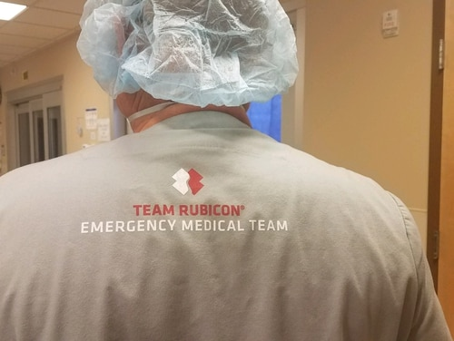 A volunteer from Team Rubicon prepares for a shift at the Kayenta Health Center in Navajo Nation in northeast Arizona. The disaster recovery charity has sent about a dozen medical workers to the site to help with coronavirus response efforts. (Courtesy of Team Rubicon)