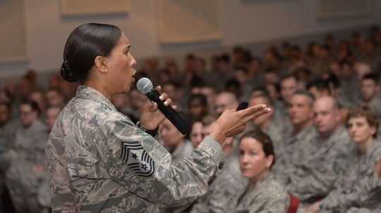 Chief Master Sgt. Sonia Lee, command chief of the 28th Bomb Wing, speaks to airmen at Ellsworth Air Force Base in South Dakota during an all call in 2016. The Air Force is considering changing rules so only master sergeants and above can issue letters of reprimand to non-commissioned officers and below. (Airman Donald Knechtel/Air Force)