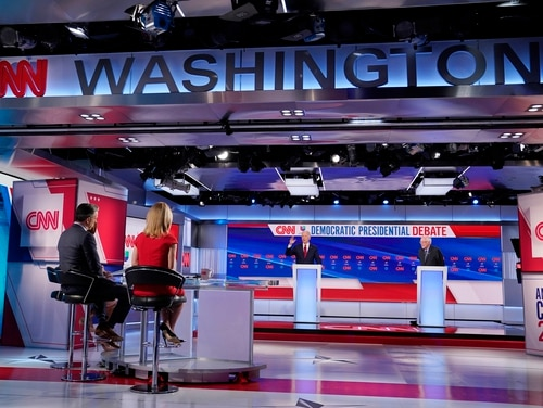 Former Vice President Joe Biden, center, and Sen. Bernie Sanders, I-Vt., far right, participate in a Democratic presidential primary debate at CNN Studios in Washington on March 15, 2020. (Evan Vucci/AP)