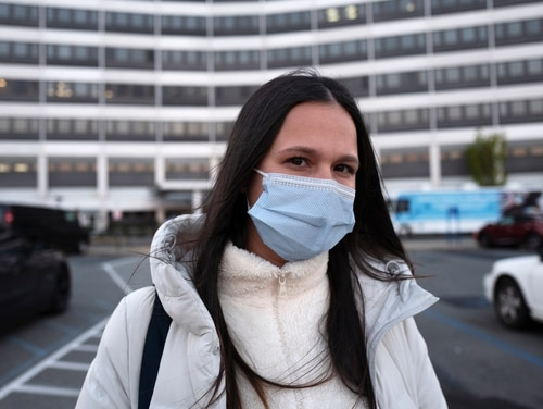 Nurse Heather Espinal stands in front of the James J. Peters Department of Veterans Affairs Medical Center where she works in New York City on April 22, 2020. (Mark Lennihan/AP)