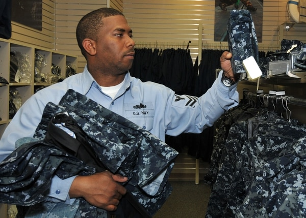 100211-N-2013O-003 YOKOSUKA, Japan (Feb. 11, 2010) Interior Communications Electrician 1st Class Shawn Sutphin, from Norfolk, examines a Navy Working Uniform eight point cover in the Fleet Exchange at Fleet Activities Yokosuka. (U.S. Navy photo by Mass Communication Specialist 3rd Charles Oki/Released)