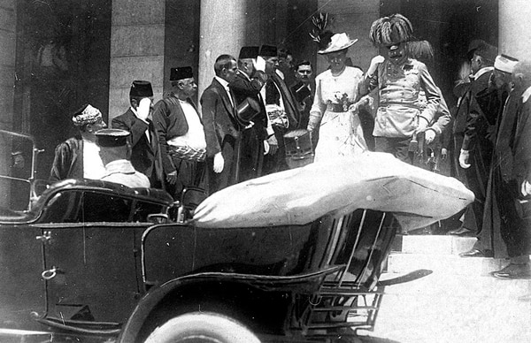 In this June 28, 1914 photo, the Archduke of Austria Franz Ferdinand, center right, and his wife Sophie, center left, walk to their a car in Sarajevo. This photo was taken minutes before the assassination of the Archduke and his wife, an event which set off a chain reaction of events which would eventually lead to World War I. (AP)