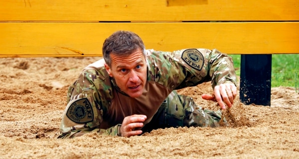 In this April 22, 2017, photo, Missouri Gov. Eric Greitens crawls under an obstacle during the SEMO SWAT Challenge in Fredericktown, Mo. (Jacob Scott/Daily Journal via AP)