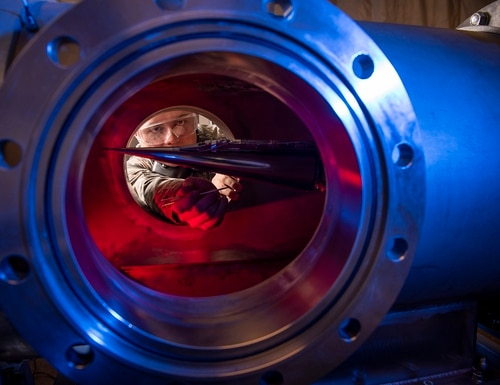 In this Jan. 31, 2019, image provided by the U.S. Air Force Academy, Cadet 2nd Class Eric Hembling uses a Ludwieg Tube to measure the pressures, temperatures, and flow field of various basic geometric and hypersonic research vehicles at Mach 6 in the United States Air Force Academy's Department of Aeronautics, in Colorado Springs, Colo. (Joshua Armstrong/U.S. Air Force Academy via AP)