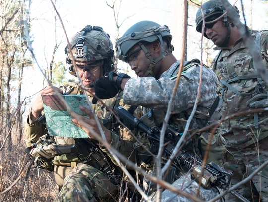 Capt. Kristopher Farrar, an infantryman assigned to the 1st Security Forces Assistance Brigade, advises his simulated partner on maneuvering through the wood line to reach their objective during a Joint Readiness Training Center rotation at Fort Polk, La. (Sgt. Arjenis Nunez/Army)