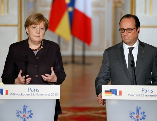 French president Francois Hollande, right, and German Chancellor Angela Merkel attend a press conference at the Elysee Palace, in Paris, Wednesday, Nov. 25, 2015. Merkel's visit to Paris is part of president Hollande's diplomatic offensive to get the international community to bolster the campaign against the Islamic State militants. (AP Photo/Francois Mori)
