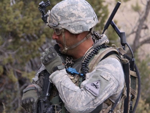 A soldier from 2nd Brigade, 1st Armored Division uses a Handheld, Manpack, and Small Form Fit Manpack radio to communicate while conducting dismounted operations at the Army's Network Integration Evaluation 13.1 on Nov. 9, 2012. The Manpack allows small units in austere environments to exchange voice and data information with their higher headquarters, without having to rely on a fixed infrastructure. (Claire Heininger/Army)