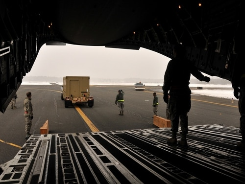Members of the Massachusetts Air National Guard load equipment onto a C-17 bound for Leeuwarden Air Base, Netherlands, as part of a theater security package. (Tech. Sgt. Lindsey Sarah Watson-Kirwin/Air National Guard)