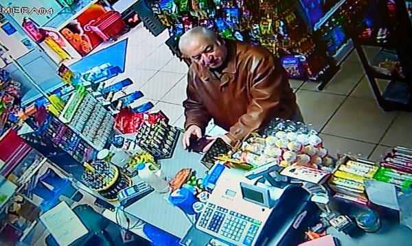 A still image from CCTV footage recorded on Feb. 27, 2018, shows former Russian spy Sergei Skripal buying groceries at the Bargain Stop convenience store in Salisbury, England. British detectives on March 8 scrambled to find the source of the nerve agent used in the