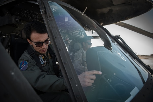 An Afghan Mi-17 pilot takes a first look at the cockpit of an Afghan Air Force UH-60 Black Hawk helicopter at Kandahar Airfield, Afghanistan. (Staff Sgt. Alex Riedel/ Air Force)