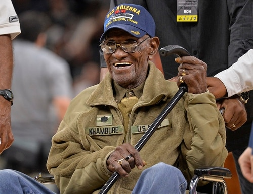 Richard Overton leaves the court after a special presentation honoring him as the oldest living American war veteran during a timeout in a March 2017 NBA basketball game. The family of Richard Overton says Social Security and banking account numbers for the 112-year-old Austin man were used to make seven withdrawals over the past several months. (AP Photo/Darren Abate, File)