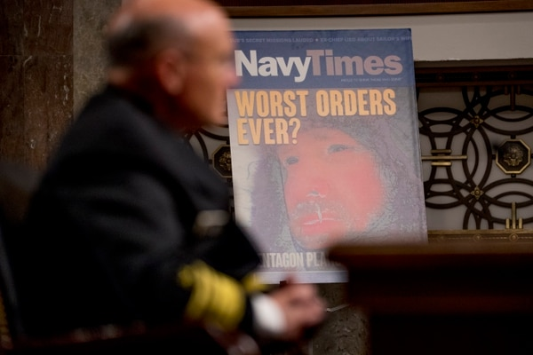 A poster of a Navy Times cover titled
