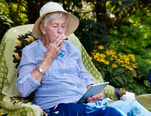 A senior fires up a J before being magically transported to Kenya. (Getty Images)