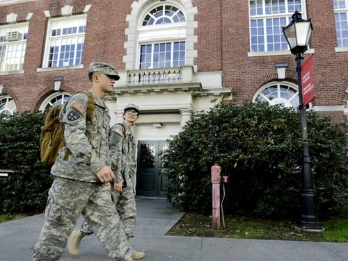 Brown University students and Army ROTC cadets walk together on the school's campus, in Providence, R.I. The Army is hoping to recruit more soldiers from urban areas. (Steven Senne/AP)