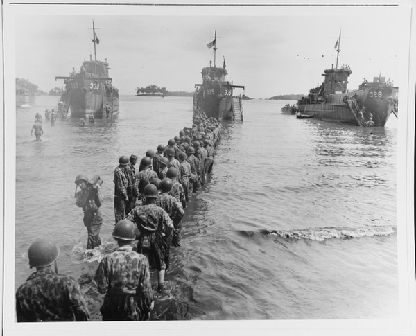 U.S. troops unloading ammunition during landing operations at Rendova Island, 30 June 1943. (National Archives)