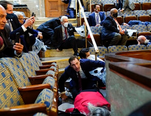 People shelter in the House gallery as pro-Trump rioters try to break into the House Chamber at the U.S. Capitol on Wednesday, Jan. 6, 2021, in Washington. (Andrew Harnik/AP)