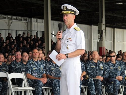Navy Adm. John Richardson speaks to sailors in Pearl Harbor, Hawaii on Tuesday, Oct. 13, 2015. The Navy's top officer says the service is considering extending paternity leave for new fathers. (AP Photo/Audrey McAvoy)