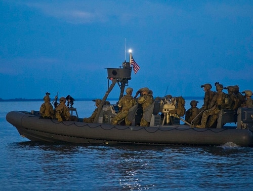 Marines with the Maritime Raid Force, 22nd Marine Expeditionary Unit prepare to launch a maritime raid on a vessel from a Rigid Inflatable Boat during a Visit, Board, Search and Seizure course at Fort Eustis, Virginia, July 16. (Lance Cpl. Ethan Green/Marine Corps)