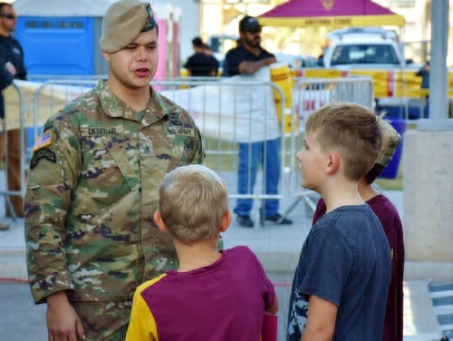 An Army Ranger talks to a group of boys at Arizona State University's Salute to Service college football game Nov. 10. Phoenix is one of the Army's key target cities in an urban recruiting push. (Alun Thomas/Army)